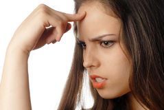 Make a adequate choice. Young thinking woman making a decision with finger at her forehead Stock Photo