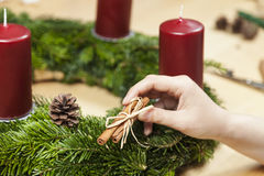Make an Advent wreath. Decorate an advent wreath with cinnamon royalty free stock images