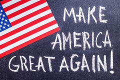 Make America great again on the chalk board and US flag stock images