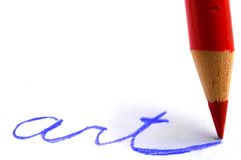 Make art. Closeup of a red colored pencil writing art Stock Photography