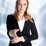 Make a bargain. Closeup portrait of attractive business woman stretches out her hand for a handshake with partner, make a bargain, successful career concept Stock Photos
