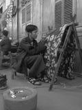 Make Batik. A young man was making original art, batik Indonesia Stock Photo