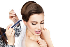 Make a beautiful bride hairstyle. Stock Photos