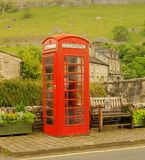 Make a Call, phone booth,Kettlewell. An old style red phone booth in the attractive village of Kettlewell, North Yorkshire stock photos