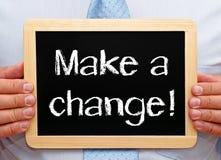 Make a change - Businessman holding chalkboard Royalty Free Stock Photography