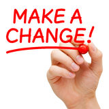 Make a Change. Hand writing Make a Change with red marker on transparent wipe board stock image