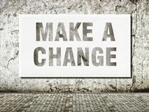 Make a change, words on wall royalty free stock image