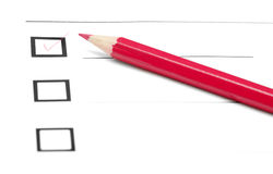 Make choice. Red pencil on a inquiry form with checkboxes Stock Image