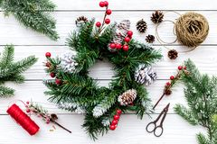 Make christmas wreath. Spruce branches, cones, threads, twine, sciccors on white wooden background top view Royalty Free Stock Images