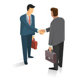 Make a deal. Full length portrait of two businessman shaking hands in making a deal or  an agreement Royalty Free Stock Photography