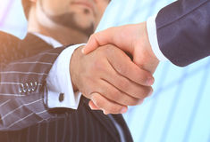 Make a deal. Handshake shot from  low angle against the background of the business center Royalty Free Stock Photography