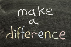 Make a difference. Phrase handwritten on blackboard Royalty Free Stock Photography