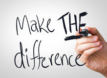 Make the difference hand writing with a black mark on a transparent board Stock Photos