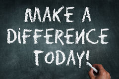 Make a difference. Hand writing with chalk on chalkboard make a difference today Royalty Free Stock Image
