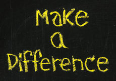 Make a difference phrase on blackboard. Make a difference motivational phrase handwritten with white chalk on blackboard Stock Photos