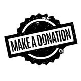 Make A Donation rubber stamp. Grunge design with dust scratches. Effects can be easily removed for a clean, crisp look. Color is easily changed Royalty Free Stock Photo