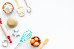 Make dough. Ingedients flour, eggs near cookware on white background top view copy space. Make dough. Ingedients flour, eggs near cookware on white background royalty free stock photography