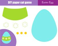 Make Easter Egg with glue and scissors. Paper cutting activity. DIY children educational creative game. Make Easter Egg with glue and scissors. Paper cutting Stock Photo