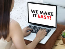 WE MAKE IT EASY! Business team hands at work with financial repo Stock Images