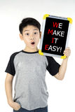 WE MAKE IT EASY! message on white board Royalty Free Stock Photo