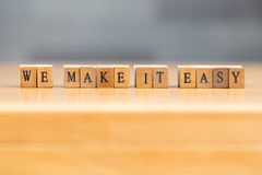 We make it easy. word written on wood block Royalty Free Stock Photography