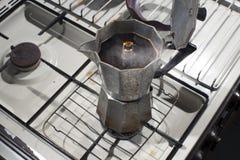 Make espresso coffee with an espresso mocha pot. royalty free stock photography