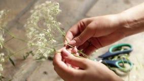 Make flower decoration in a vase stock footage