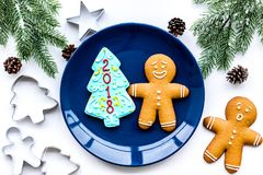 Make gingerbread cookies for New Year at home. Bakery and cutters on white background top view Royalty Free Stock Photos