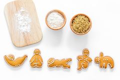 Make gluten free healthy food. Yoga asanas cookies near desk, flour and wheat on white background top view Royalty Free Stock Photos