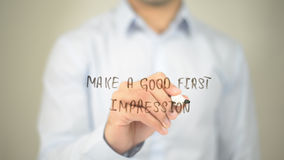 Make A Good First Impression , man writing on transparent screen. High quality Royalty Free Stock Photos