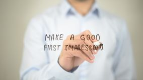 Make A Good First Impression , man writing on transparent wall royalty free stock image
