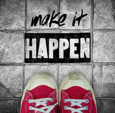 Make it happen : inspiration quotation. Over red canvas sneaker on pavement backgound stock photography