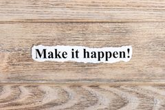 make it happen text on paper. Word make it happen on torn paper. Concept Image stock photo