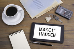 Make It Happen. Text on tablet device on a wooden table Royalty Free Stock Photos