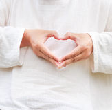 Make heart from his hand. Stock Photography