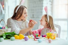 Make a holiday child.Mom and daughter are preparing for Easter together.Mom and daughter have a fun.  royalty free stock photo