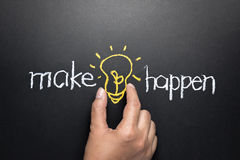 Make idea happen. Concept, hand taking light bulb between words written by chalk Stock Images