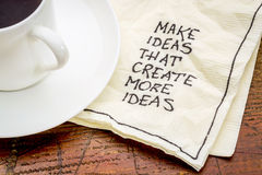 Make ideas advice on napking. Make ideas advice that create new ideas - handwritten advice on a cocktail napkin with a cup of coffee Royalty Free Stock Photography