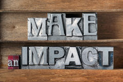 Make an impact tray. Make an impact phrase made from metallic letterpress type on wooden tray royalty free stock photo