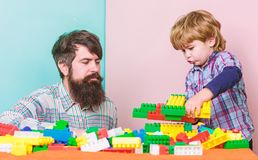 Make with inspiration. building plane with colorful constructor. love. child development. small boy with dad playing stock images