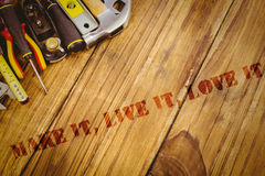 Make it, live it, love it against desk with tools Stock Photo