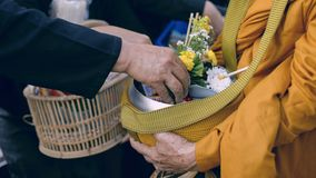 Make merit make offerings to the monk In Buddhism Royalty Free Stock Photos