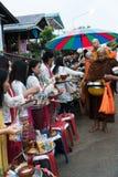 Make merit with monk Stock Photo
