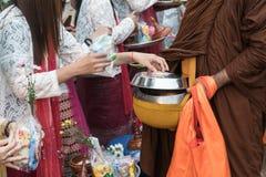 Make merit with monk. Kanchanaburi, Thailand - January 12, 2017:Traveler crowd make merit with monk in morning at Sangkhlaburi District, Kanchanaburi Thailand Stock Images