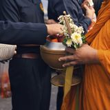 Make merit make offerings to the monk In Buddhism.  Stock Images