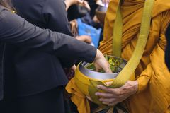 Make merit make offerings to the monk In Buddhism.  Stock Image