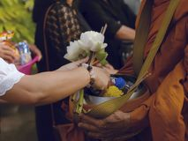 Make merit make offerings to the monk In Buddhism Stock Photography