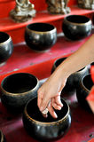 Make merit. People make merit by put the coint into the monk's alms-bowl, Thailand Stock Photos
