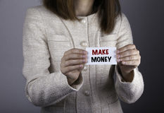 Make Money. Businesswoman holding a card with a message text wri Royalty Free Stock Photos