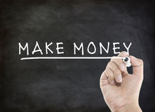 Make money concept on blackboard Royalty Free Stock Images